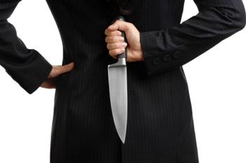 Knife behind back