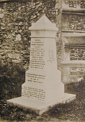 The tombstone as it appeared in a photograph in Frederick Perigal's memoir. The dissection diagram is on the invisible face around to the left. The diagram on the right illustrates a fact about parabolas.