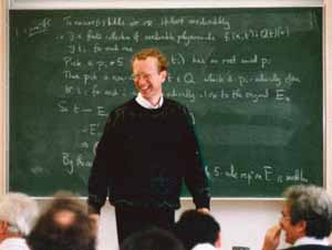 Andrew Wiles in front of a blackboard