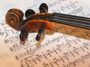 IMAGE: violin resting on a musical score