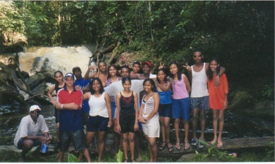Adrian with students in Guyana