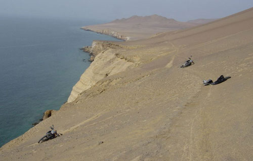 Motorbikes abandoned after a close call on a cliff in Peru