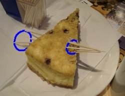 A cake with cocktail sticks through the circle