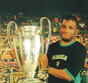 Nira holding the Champions League trophy.