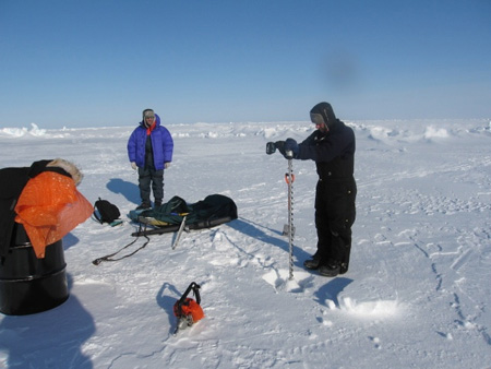 Drilling a hole in the ice