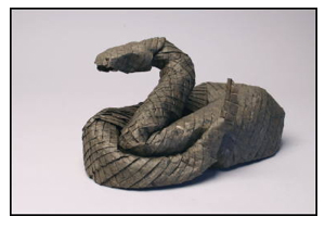 <i>Rattlesnake</i> made from one uncut rectangle of Thai unryu paper. Size: 8 inches. Image courtesy <a href='http://www.langorigami.com'>Robert J. Lang</a>.