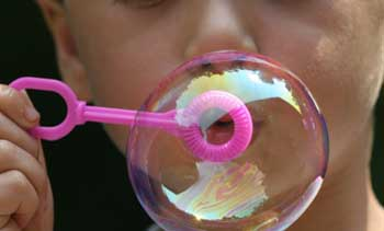 A boy blowing a soap bubble