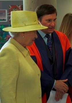 Professor John Barrow, MMP Director, explains Roadshow activities to the Queen in June